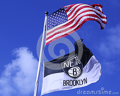 Brooklyn Nets and American flags flying in front of Barclays center Editorial Photography