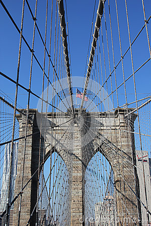 American flag on top of famous Brooklyn Bridge Editorial Photo