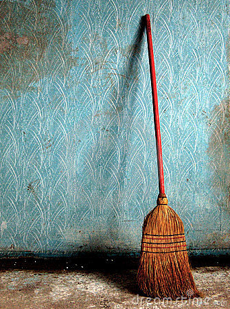 Broom on a blue wall