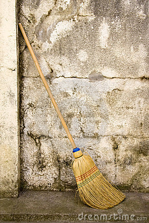 Broom in a wall