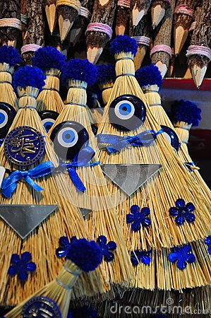 Brooms decorated with evil eyes