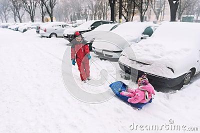 Brother pulling bob sledge