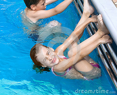 Brother sister doing exercises in pool