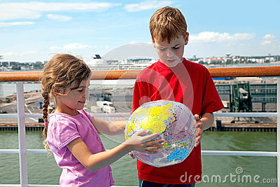 Brother and sister hold inflatable globe