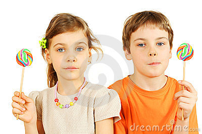 Brother and sister hold lollipops