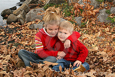 Brother and Sister Hugging at the Park