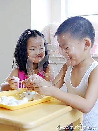 Brother and sister making dumplings