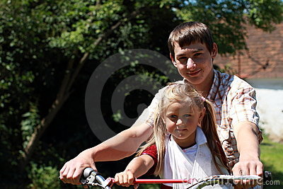 Brother and sister on a motorbike