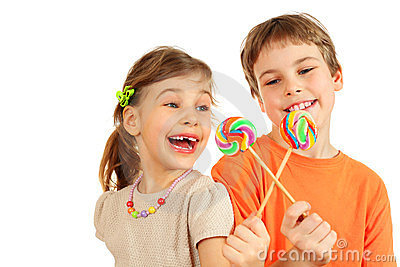 Brother and sister play with lollipops