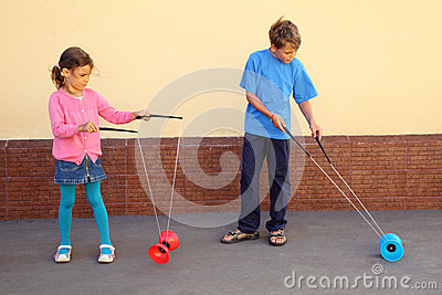 Brother and sister play with yo-yo toy