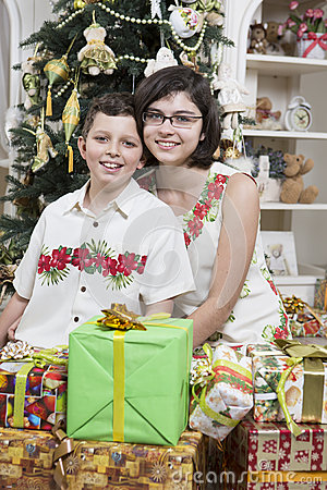 Brother and sister ready to open gifts