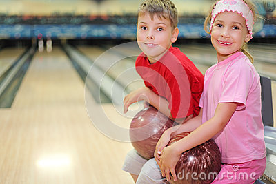 Brother and sister sit in bowling club