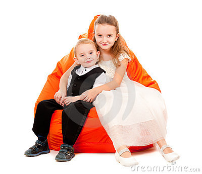 Brother and sister sitting on a chair
