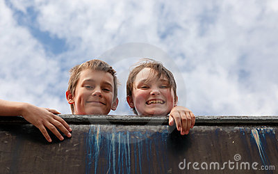 Brother and sister on wall