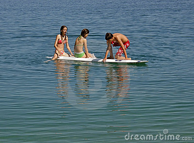 Brother and sisters on surf desk