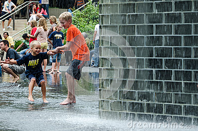 Brothers playing in the crown fountain Editorial Photo