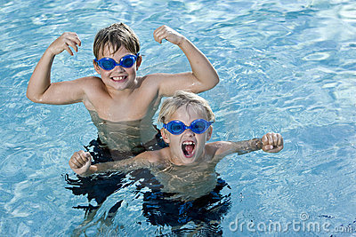 Brothers playing and shouting in swimming pool