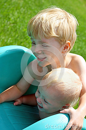 brothers playing on slide outside stock photography image 32476432. Black Bedroom Furniture Sets. Home Design Ideas