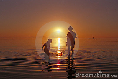 Brothers playing in the water at the Great Salt Lake beach