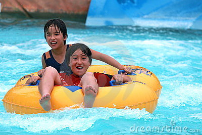 Brothers tubing in a water park