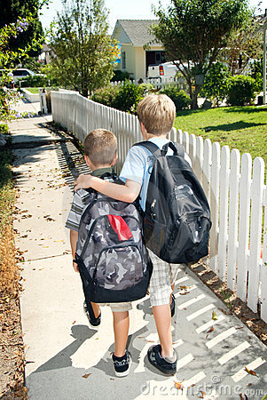 Free Brothers Walking Home From School Royalty Free Stock Image - 3017916