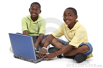 Brothers Working On Laptop Computer Sitting On Floor