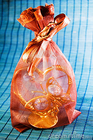 Brown bag with a golden heart/butterfly present