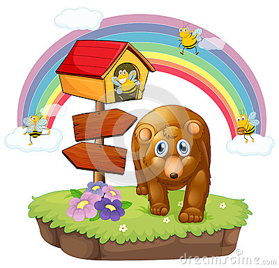 A brown bear near the pethouse and the arrow board