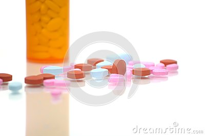 Brown, Blue, and Pink Pills with Bottle