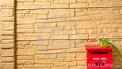 Brown brick wall with mailbox isolated