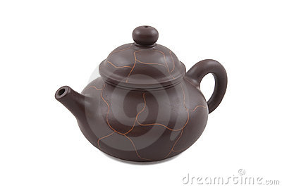 Brown ceramic teapot with abstract ornament