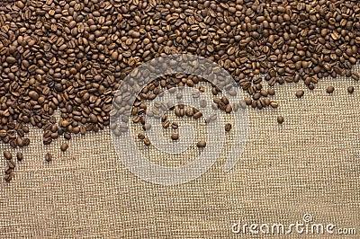 Brown coffee grains on a sacking