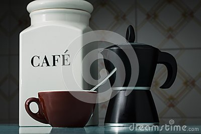 Brown cup of coffee with coffee container and mocha