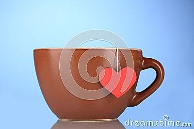 Brown cup and tea bag