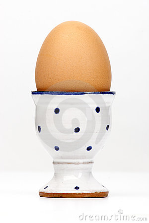 Free Brown Egg In A White Egg Cup Stock Image - 5260381