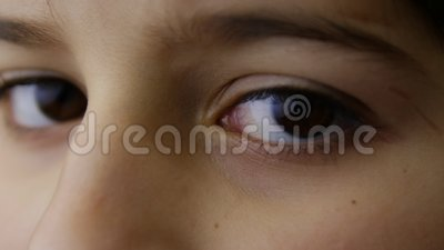 Brown eyes of young boy. Close-up shot stock video