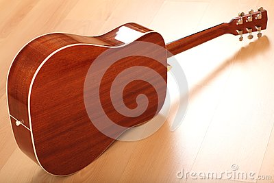 Brown guitar on neutral background