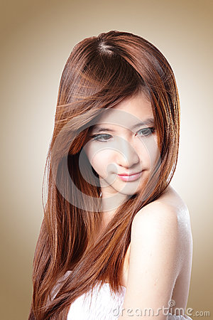 Fashion Woman with Brown Hair in wind