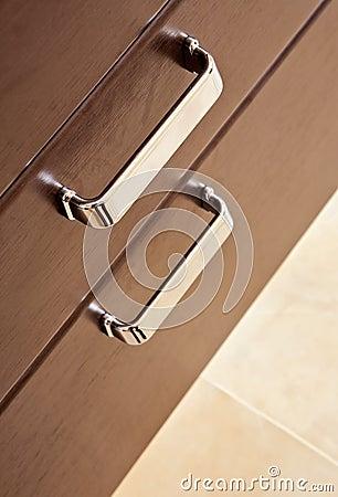 Brown hardwood drawers with metal handle