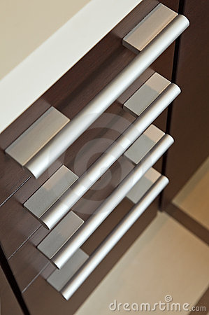 Brown hardwood drawers with metal handle