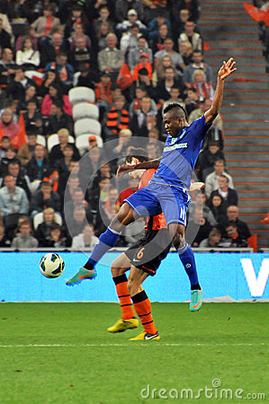 Brown Ideye jumps for the ball Editorial Stock Image