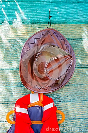 Brown leather hat and orange life jacket