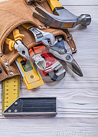 Free Brown Leather Toolbelt With Construction Tools On Wood Board Dir Stock Photo - 74933990