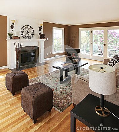 Brown livinng room with white fireplace.