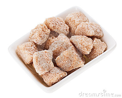 Brown lump cane sugar in a rectangular sugar-basin