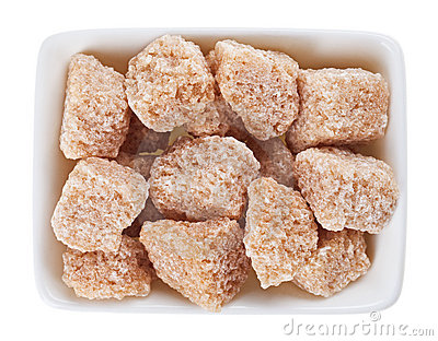 Brown lump cane sugar in sugar-basin