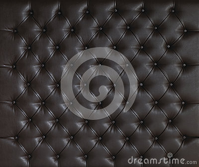 BROWN LUXURY PADDED STUDDED LEATHER BACKGROUND