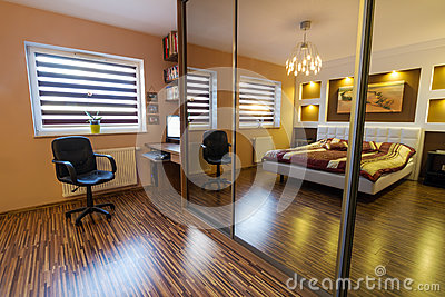 Brown master bedroom interior