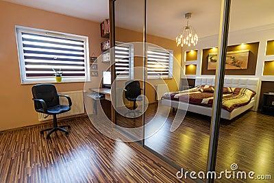 Brown master bedroom interior