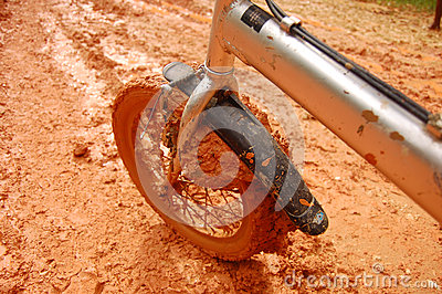 Brown muddy bycicle front wheel
